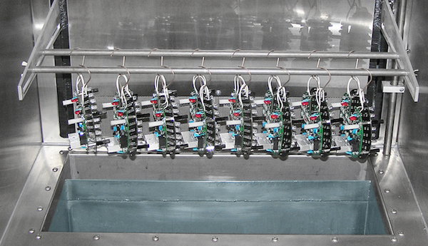 Normally a dip coating system is used for conformal coating. The system can dip multiple boards simultaneously with full control of the dip process.