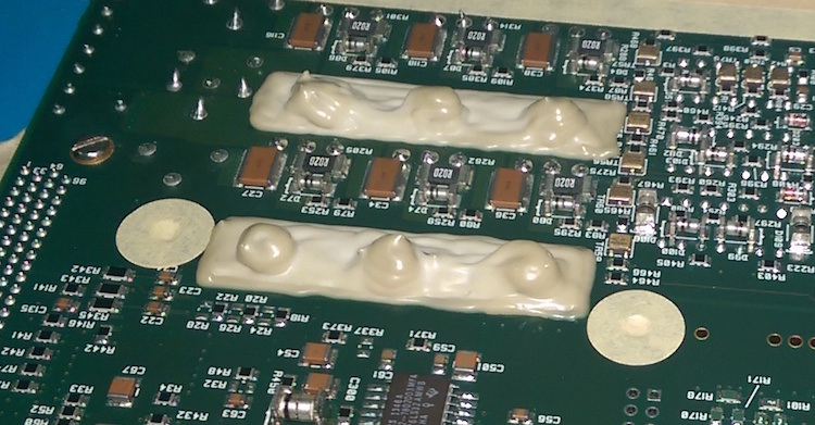 Latex used to mask a circuit board before conformal coating processing