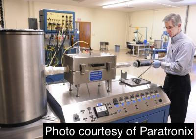 Paratronix Operations Manager Joe Monaghan installs the vapor heater on a Parylene coater. (Staff photo by Martin Gavin)