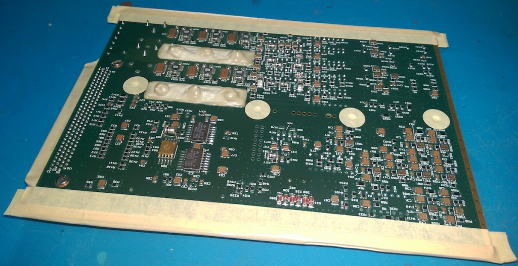 circuit board masked in tape and latex