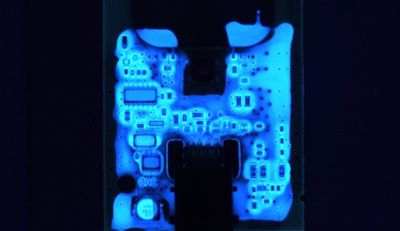 Conformal coated via's (electrical connection holes from one side of a circuit board to the other) can cause problems if they are open (not sealed) by allowing conformal coating to leak through to the other side of the board into components that should not be coated.